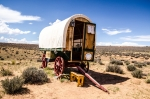 a-traditional-caravan-rests-under-blue-skies-in-the-plains.jpg